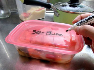 Marking a date of cooking on a food container